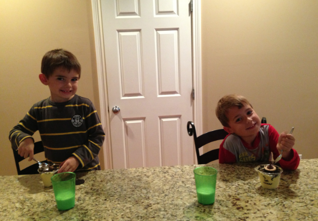 Sean and Ryan enjoying the Hersey Kiss Witch Pudding Cup