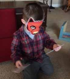 """My son wearing the """"big bad wolf"""" mask"""